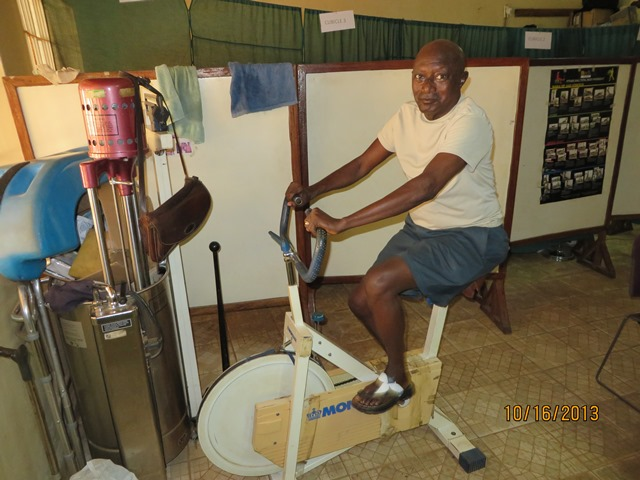 United Methodist Pastor, Rev Steven Momoh Momo-Jah doing various physical exercise at the Physical Therapy unit, UMC General Hospital, Kissy