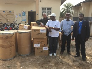 District Superintendent Rev. Deen with medical supplies in Kono