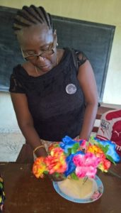 Mrs Olivia Fonnie, member Prison Ministry demonstrates to inmates at Remand Home how to design flowers